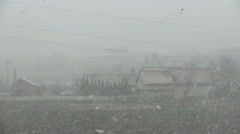 Snow storm at small city over houses Stock Footage