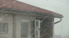 Snow storm at small city over house heating system Stock Footage