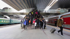 Time Lapse of passengers arrive for their train at Beijing Railway Station Stock Footage