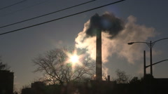Smoke stacks from industry belching carbon and gases into the environment Stock Footage