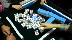 Family members playing mahjong during Chinese Lunar New Year - stock footage