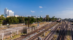 Timelapse day to night of passing cloud and traffic at railway station Stock Footage