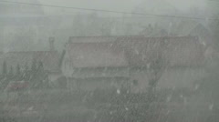 Snow storm at small city over house Stock Footage