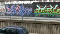 Graffiti - Urban Art - Traffic Passing Next To The Urban Art Stock Footage