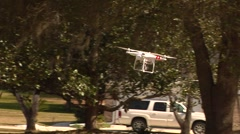 UAV-19, drone helicopter MS to CU flys to camera and hovers Stock Footage