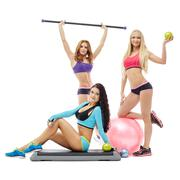 Charming young women posing with sports equipment - stock photo