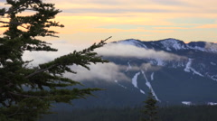 Time lapse of clouds and fog moving across the Oregon Cascade Range. - stock footage