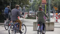 Tourists On The Bikes Following Tour Guide In The City Stock Footage