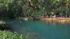 Tourists at the Blue Lagoon in Vang Vieng, Vientiane Province, Laos Stock Footage