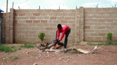 African man chopping wood Stock Footage