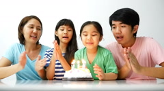 Slow motion happiness moment of Asian family blowing birthday candles Stock Footage