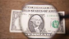American currency one hundred dollar bills through a magnifying glass Stock Footage