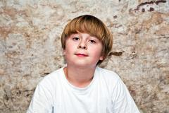 Boy with light brown hair and brown eyes lookes friendly Stock Photos