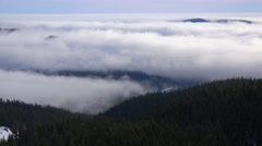 Time lapse of clouds and fog moving across the Oregon Cascade Range. Stock Footage