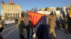 Soldiers with red flag in Independence Square, Kiev, Ukraine Stock Footage