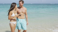 Smartphone Selfie - beach vacation couple photo with mobile cell smart phone - stock footage