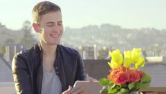 Young Professional Draws On A Tablet, Sketches The City Skyline From A Rooftop Stock Footage