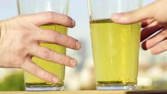 Close Up Of Two Pint Glasses Of Beer On A Rooftop Railing, Hands And Grab Pints Stock Footage