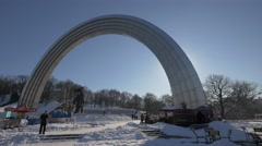 Tourists at Friendship Nations Arch, Kiev, Ukraine Stock Footage