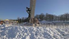 Ice skating around the People's Friendship Arch, Kiev, Ukraine Stock Footage