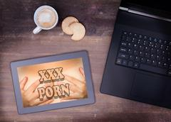 Searching online for porn - stock photo