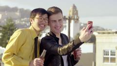 Happy Gay Couple Take A Photo Together On A Rooftop With City View - stock footage