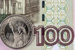 The US dollar and a hundred rubles - stock photo