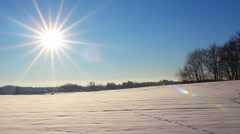 Time lapse of sun over the snowy countryside Stock Footage