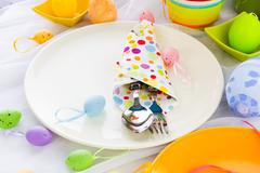 Cutlery wrapped napkin Easter table Stock Photos