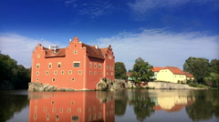 Cervena Lhota. Czech Republic. Castle on lake and  flowing clouds. Time lapse. Stock Footage