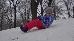 4K View of Child Sledding in Snow, Little Girl Playing, Sledging in Park, Winter Stock Footage
