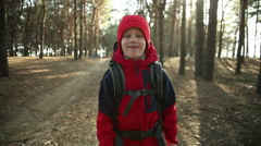 Child Walking in Adventure on Mountain Trails, Paths , hiking with backpack Stock Footage