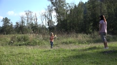 4K Mother, Child, Girl Playing Badminton on Meadow , Family Making Sport, Nature Stock Footage