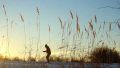 Silhouette skier  running through against the sky at sunset - stock footage