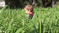 Smiling baby in thick grass Stock Footage