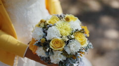 Young woman hold yellow bouquet in her arms - stock footage