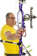 Man with bow and arrow in close up Stock Photos
