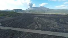 Aerial Footage Flying Towards Erupting Volcano Stock Footage