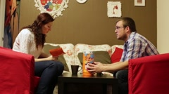 Man and woman playing in boardgame Jenga Stock Footage