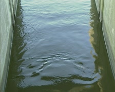 Effluent outlet of a Sewage treatment plant + zoom in water flow - full screen Stock Footage