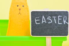 Blackboard with easter bunny on the background - stock photo