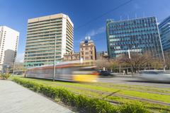 Tram in a modern green city - stock photo