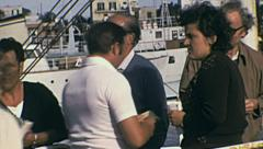 Ischia 1970s: sailors checking tickets at the entrance of the ferry Stock Footage