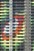 Exterior of a colorful buiilding under construction - stock photo