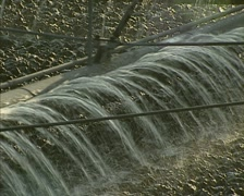 Full screen - moving carrousel spraying wastewater in lava bed filtration Stock Footage