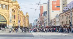 Busy crosswalk outside Flinders Street Station in Melbourne Stock Photos