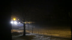 Snow plow truck at night plowing Stock Footage