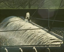 Carousel moving across lava bed, spraying wastewater, biological filtration Stock Footage