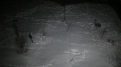 Snow tracks at night snowy land Stock Footage