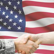 Soldier and doctor shaking hands with flag on background - United States Stock Illustration